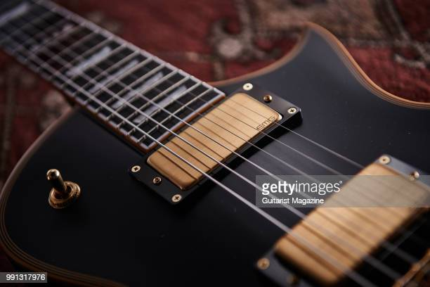 Detail of the EMG 60 humbucker on an ESP EII Eclipse DB electric guitar with a Vintage Black finish taken on October 10 2017
