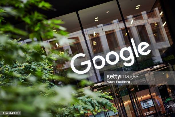 Detail of the entrance to the Google UK offices in London with the Google logo visible above the doorway taken on June 4 2019