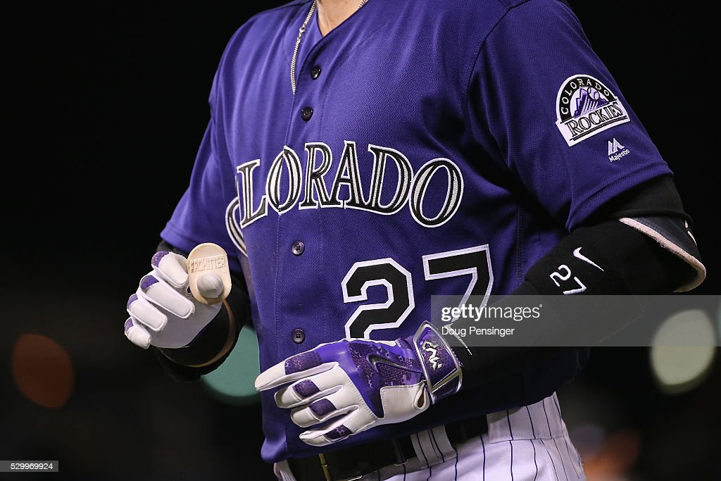 Detail of the equipment and hands of Trevor Story #27 of the Colorado Rockies as he takes an at bat against the Arizona Diamondbacks at Coors Field on May 09, 2016 in Denver, Colorado. The Diamondbacks defeated the Rockies 10-5.