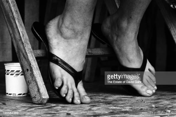 Detail of the feet and sandals of folk singer Mary Travers on stage performing in an afternoon workshop of spirituals and traditional gospel music in...