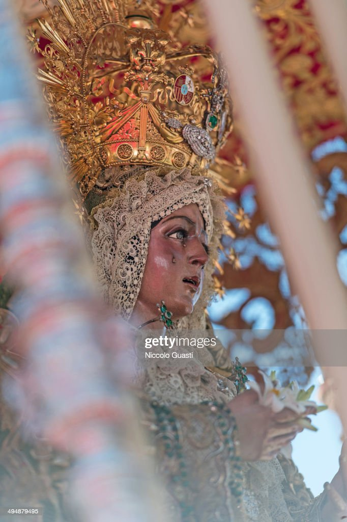 A detail of the figure of the Virgin during the 50th Anniversary of 'La Macarena' crowning in the 'Plaza de Espana' Square on May 31, 2014 in Seville, Spain. Seville locals and visitors from around the world come in the masses to observe the grande celebration of the Jubilee Year of La Macarena held to mark the 50th anniversary of the canonical coronation of the Virgin of La Macarena, a 17th century Roman Catholic wooden image of the Blessed Virgin Mary venerated in Seville and one of the city's most popular symbols.