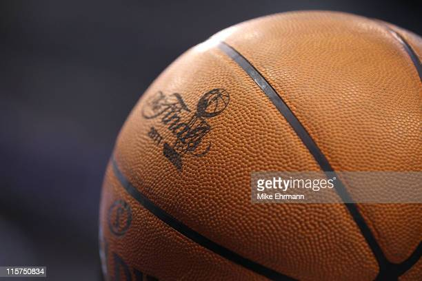 A detail of the finals logo is seen on an offical spandling basketball as the Dallas Mavericks host the Miami Heat in Game Four of the 2011 NBA...