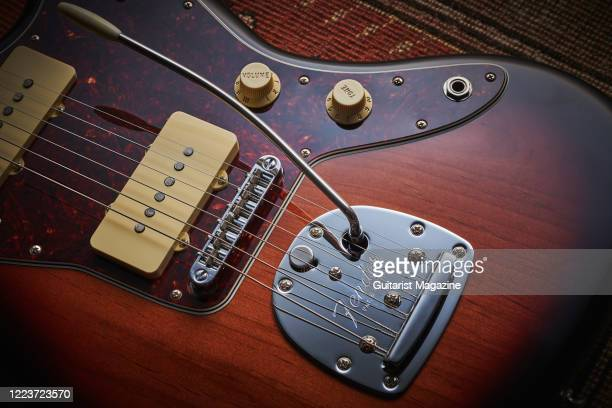 Detail of the floating tremolo tailpiece on a Fender Vintera 60s Jazzmaster Modified electric guitar with a 3-Colour Sunburst finish, taken on August...