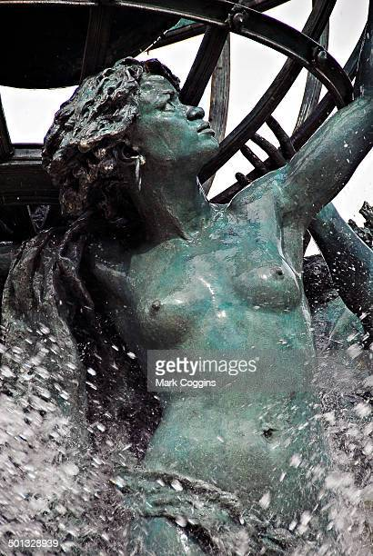 Detail of the Fontaine de l'Observatoire in Paris, showing one of the four women in the fountain sculpture holding a celestial sphere over her head....