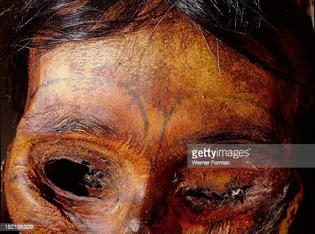Detail of the forehead of a tattooed female mummy, Created by soot stained or dyed thread drawn under the skin by a needle, these designs apparently...