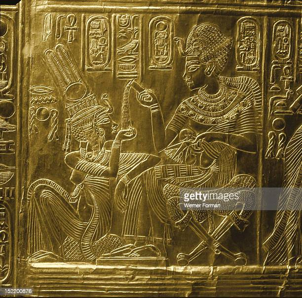 A detail of the gilt shrine of Tutankhamun which originally contained statuettes of the royal couple Tutankhamun and Queen Ankhesenamun ritual scene...