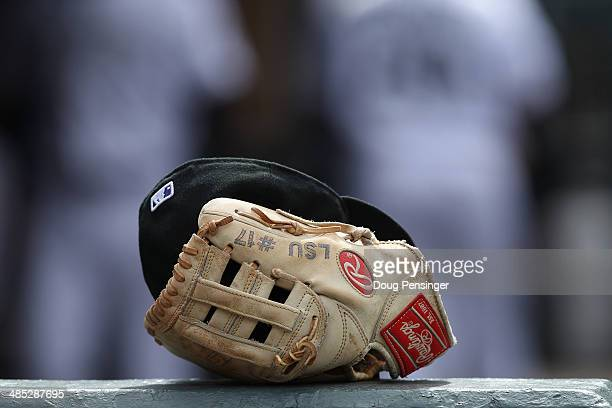 A detail of the glove of DJ LeMahieu of the Colorado Rockies shows his college while playing at LSU as it lies in the dugout as they face the Chicago...