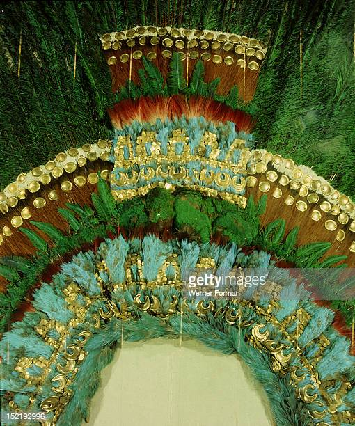 Detail of the gold and featherwork headdress given by Montezuma to Cortes as a gift for his sovereign, Mexico. Aztec.