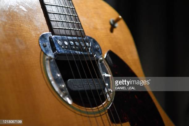 A detail of the guitar used by musician Kurt Cobain during Nirvana's famous MTV Unplugged in New York concert in 1993 is pictured at the Hard Rock...