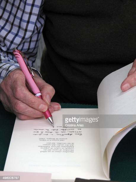 Detail of the hand of the poet Marcos Ana while writing a dedication in a copy of one of his books at Book Fair 2013 in the Retiro Park in Madrid,...