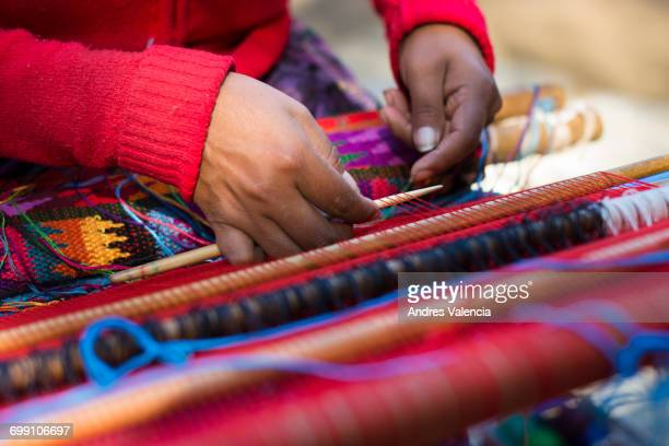 detail of the hands of a mayan woman weaving a huipil. - guatemala stock pictures, royalty-free photos & images
