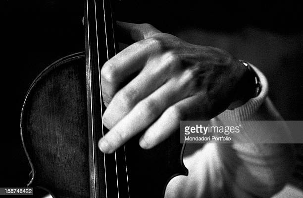 Detail of the hands of Italian violinist Uto Ughi playing the violin Val Badia January 1970