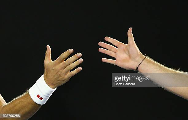 Detail of the hands of Novak Djokovic of Serbia and Quentin Halys of France as they shake hands at the net after Novak Djokovic won in his second...