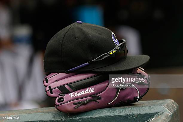 A detail of the hat sunglasses and glove of Brandon Barnes of the Colorado Rockies in the dugout as they face the Philadelphia Phillies at Coors...