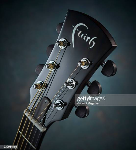Detail of the headstock and Grover Rotomatic tuners on a Faith Neptune Blue Moon electro-acoustic guitar with a Blue Burst finish, taken on January...