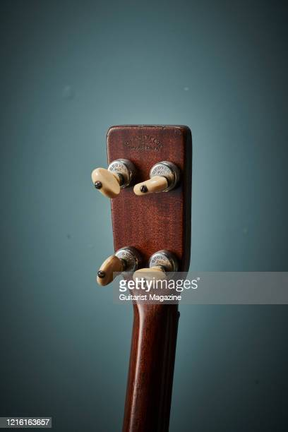Detail of the headstock and Grover tuners on a vintage 1929 Martin 0-18T acoustic guitar, taken on April 5, 2019.