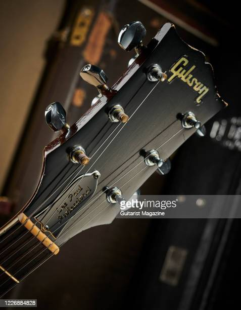 Detail of the headstock and Schaller tuners on a vintage 1969 Gibson Les Paul Professional electric guitar with a transparent Walnut finish taken on...