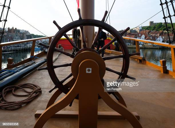 Detail of the helm of HM Bark Endeavour, a replica of Captain Cook's famous ship, HMS Endeavour as it is tied up in Whitby Harbour following...