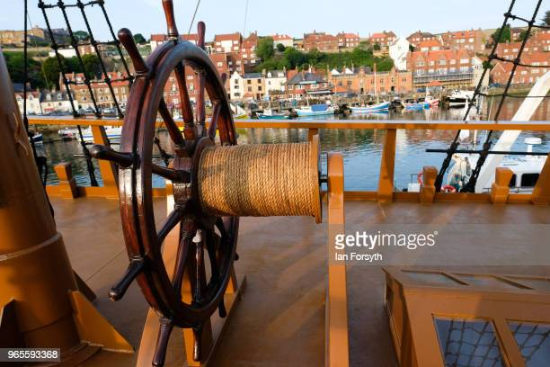 A detail of the helm of HM Bark Endeavour a replica of Captain Cook's famous ship HMS Endeavour as it is tied up in Whitby Harbour following...