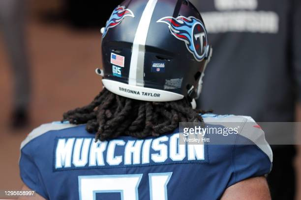 """Detail of the helmet worn by defensive tackle Larrell Murchison of the Tennessee Titans as it reads """"Breonna Taylor"""" prior to their AFC Wild Card..."""