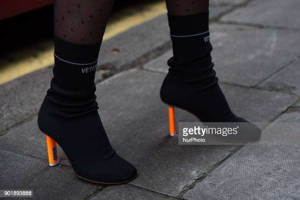 Detail of the iconic Stretch-jersey ankle boots by the french brand Vetements, outside the BFC Showspace at the Strand, during the London Fashion...