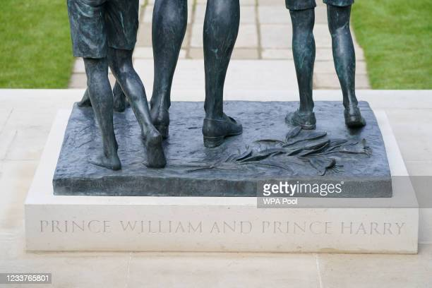 Detail of the inscription 'Prince William and Prince Harry' on the statue of Diana, Princess of Wales, ahead of the first members of the public being...