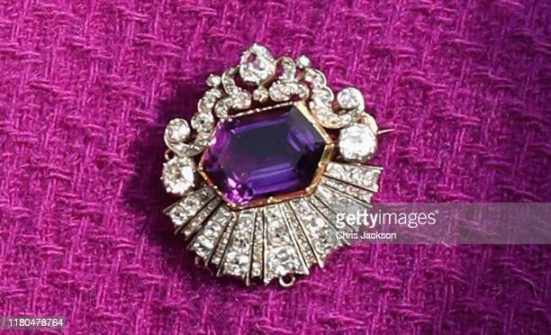 Detail of the Kent Amethyst brooch as Queen Elizabeth II visits the Royal British Legion Industries village to celebrate the charity's centenary year...