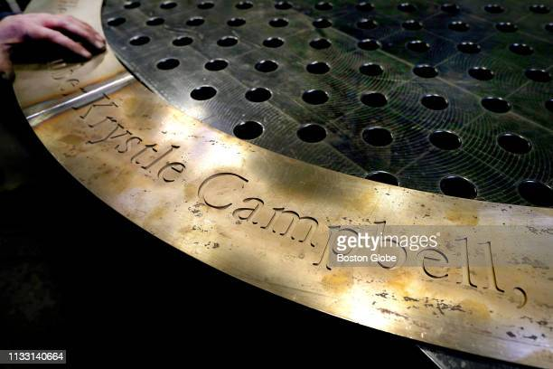 A detail of the large bronze circle that will surround the base of a granite monument to be placed on the sidewalk of Boylston Street near the Boston...