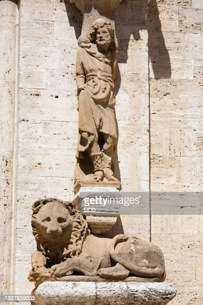 Detail of the lateral portal, Collegiata or Pieve di Osenna, San Quirico d' Orcia, Tuscany, Italy, Europe.
