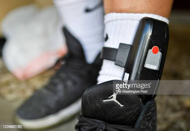 Detail of the Libre by Nexus electronic ankle bracelet that Nefi Flores has to wear around the clock. Portrait and photos of Nefi Flores on Saturday,...
