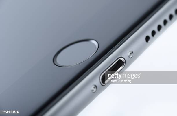 Detail of the lightning connector and Touch ID sensor on an Apple iPhone 6s smartphone taken on September 28 2015