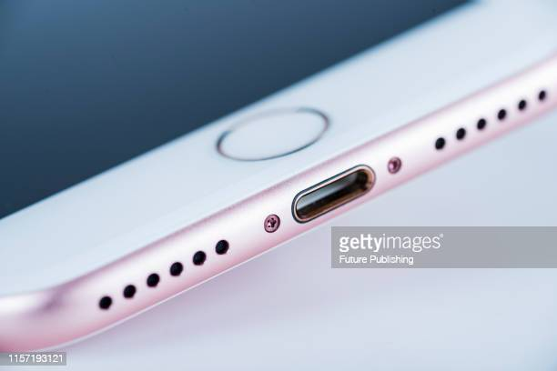 Detail of the lightning port on a 2016 Apple iPhone 7 smartphone with a Rose Gold finish taken on September 22 2016