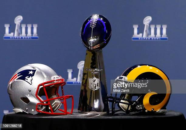 Detail of the Lombardi Trophy and the helmets of the New England Patriots and the Los Angeles Rams priot to NFL Commissioner Roger Goodell speaking...