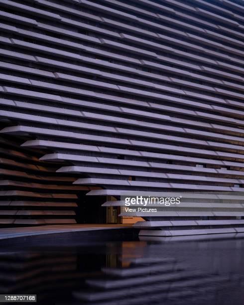 Detail of the main entrance at dusk. V&A Dundee, Dundee, United Kingdom. Architect: Kengo Kuma and Associates, 2018.