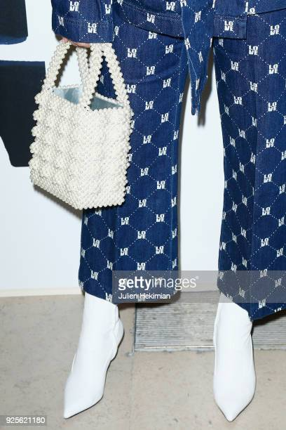 A detail of the Marie Ange Casta's bag and shoes pictured during the HM show as part of the Paris Fashion Week Womenswear Fall/Winter 2018/2019 on...
