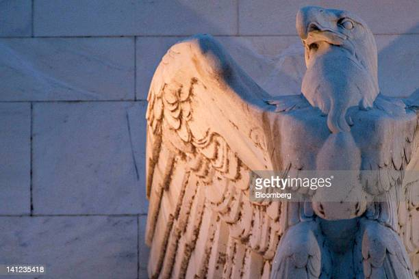 Detail of the Marriner S. Eccles Federal Reserve building is photographed in Washington, D.C., U.S., on Tuesday, March 13, 2012. Federal Reserve...