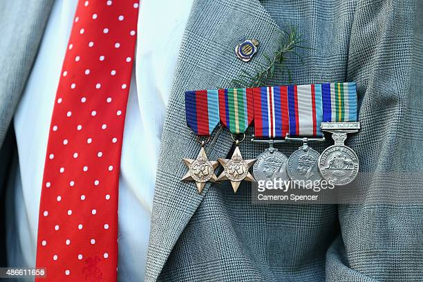 Detail of the medals worn by Army veteran and former Dragons player Bill Collier waves to the crowd during the round 8 NRL match between the St...