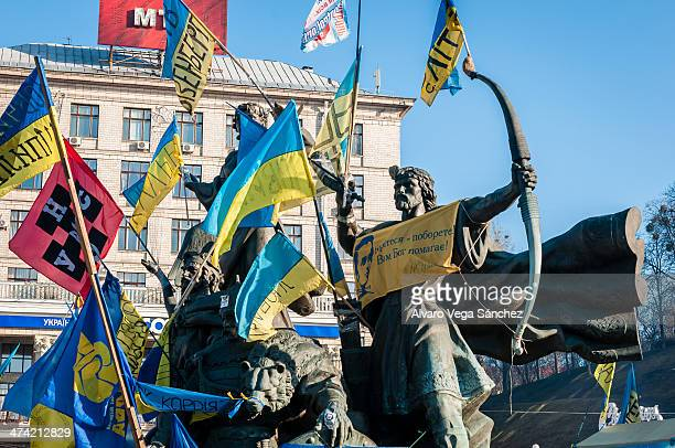 Detail of the monument to the founders of Kiev in the Euromaidan during the riots and social unrest.