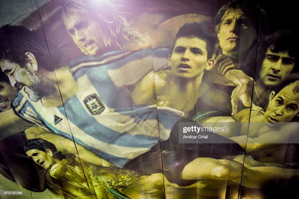 Detail of the mural in the ceiling of Sportivo Pereyra de Barracas club on June 13, 2018 in Buenos Aires, Argentina. The mural was painted in the ceiling of the pitch by local artist Santiago Barbeito depiciting the 'Creation of Adam' and making a tribute to Argentin football stars.
