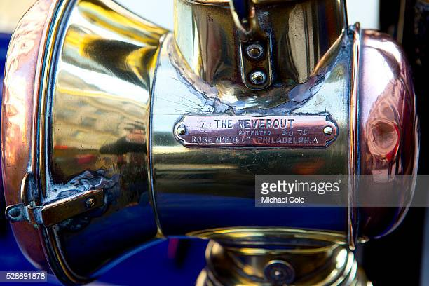 Detail of The Neverout brass copper headlamp on 1904 Autocrat on show in Regent Street London