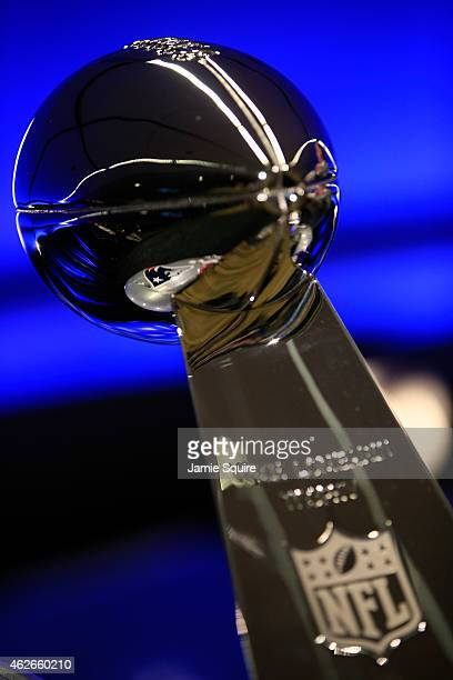 A detail of the New England Patriots logo reflected in the Vince Lombardi trophy during a press conference with New England Patriots head coach Bill...