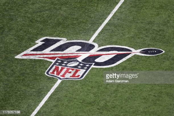 A detail of the NFL 100 logo on the field during the game between the New England Patriots and the Pittsburgh Steelers at Gillette Stadium on...