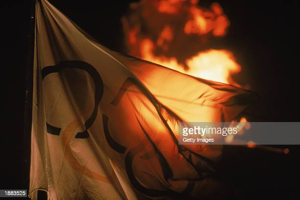 Detail of the Olympic Flame as it burns behind the Olympic flag during the 1992 Winter Olympic Games on February 8, 1992 in Albertville,...