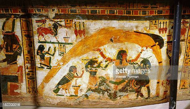 A detail of the painted sarcophagus of Butehamun In the act of creation the air god Shu holds aloft the sky goddess Nut separating her from Geb Egypt...