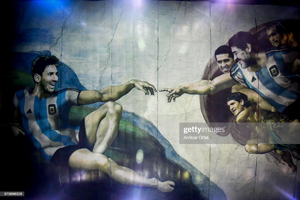 Detail of the painting on the ceiling of Sportivo Pereyra de Barracas Club on June 13, 2018 in Buenos Aires, Argentina. The mural was painted in the ceiling of the pitch by local artist Santiago Barbeito depiciting the 'Creation of Adam' and making a tribute to Argentin football stars.