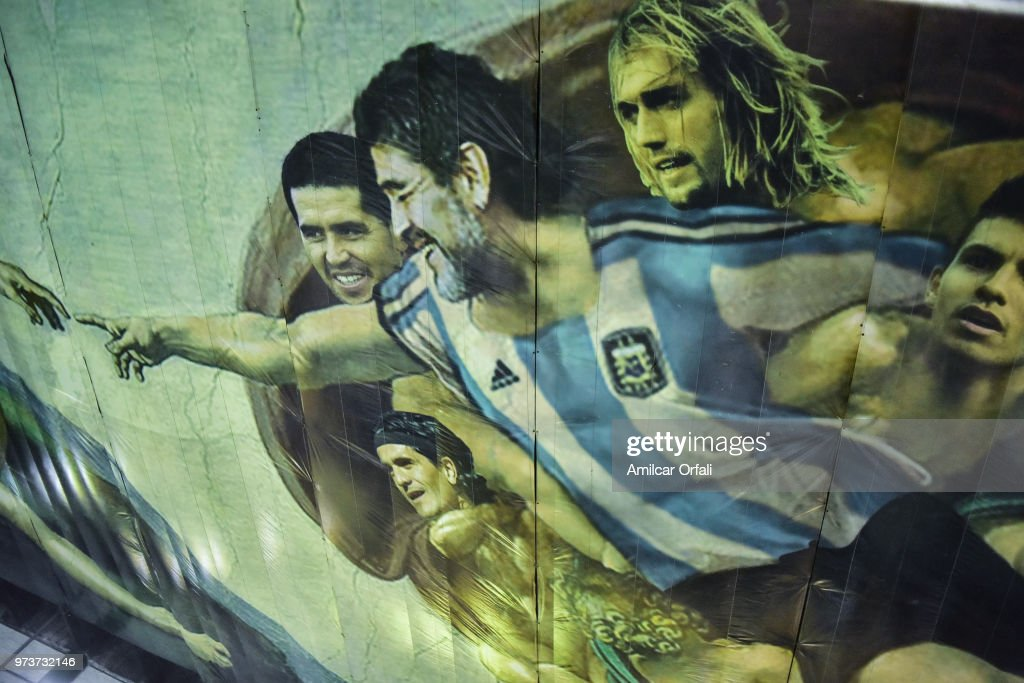 Detail of the painting on the ceiling of Sportivo Pereyra de Barracas Club where Diego Maradona is portrayed as Christ on June 13, 2018 in Buenos Aires, Argentina. The mural was painted in the ceiling of the pitch by local artist Santiago Barbeito depiciting the 'Creation of Adam' and making a tribute to Argentin football stars.