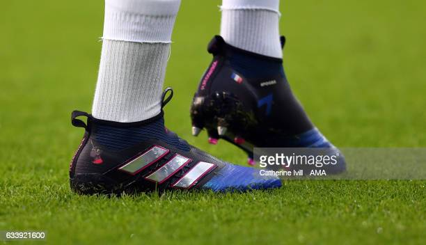 Detail of the personalised boots of Paul Pogba of Manchester United with his face on them during the Premier League match between Leicester City and...