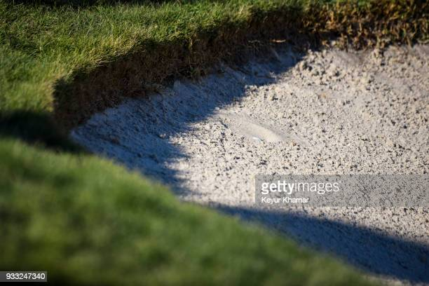 A detail of the plugged ball of Rickie Fowler in a bunker on the 18th hole during the third round of the Arnold Palmer Invitational presented by...