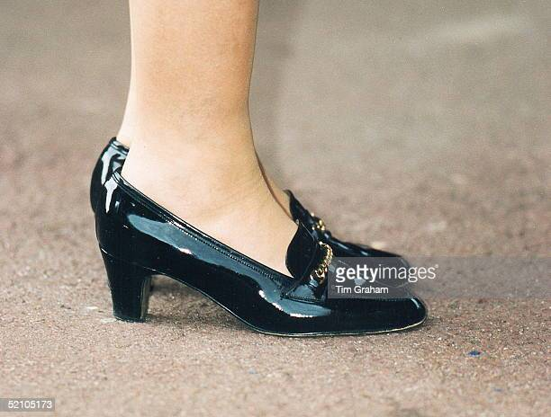 Detail Of The Queen's Black Patent Leather Shoes