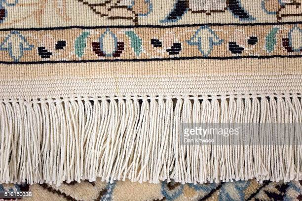 A detail of the reverse of a Persian 'Nain' rug at the Oriental Rug Centre's main warehouse on March 17 2016 in London England The Oriental Rug...